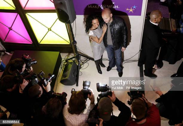 Spice Girl Mel B and her husband Stephen Belafonte as they arrive to meet shoppers at Selfridges on Oxford Street central London where she sang...