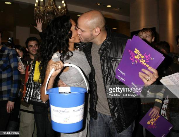 Spice Girl Mel B and her husband Stephen Belafonte kiss before Mel sang Christmas carols to shoppers instore at Selfridges to help raise donations...