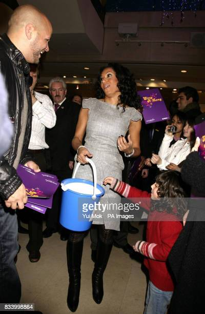 Spice Girl Mel B and her husband Stephen Belafonte meet shoppers at Selfridges on Oxford Street central London where she sang Christmas carols to...