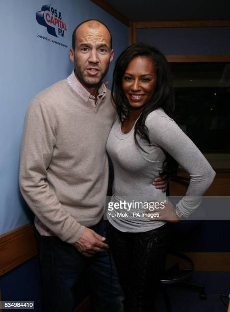 Spice girl Melanie Brown with presenter Johnny Vaughan during her visit to the Capital Breakfast Show at Global FM in Leicester Square central London...