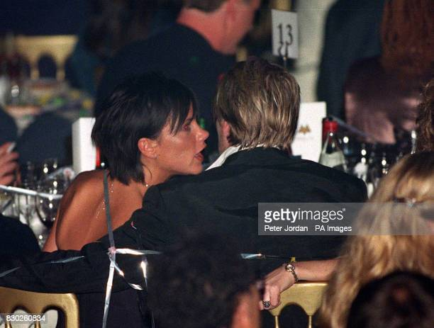 Spice Girl Victoria Beckham talks to her husband Manchester United footballer David Beckham during the MOBO Awards held at London's Royal Albert Hall