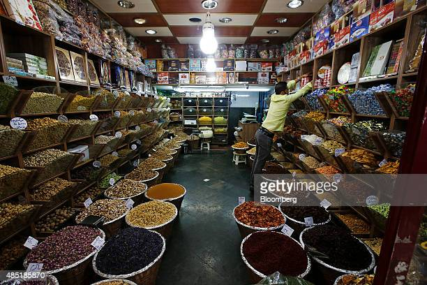 A spice seller adjusts his display at his store inside the Tajrish bazaar in Tehran Iran on Sunday Aug 23 2015 Iran the world's fifth largest crude...