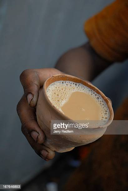 Spiced Indianstyle tea 'chai' served with milk in a disposable clay cup as served in a tea stall along a road in the Chowringhee district of Kolkata...