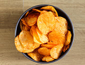 close up of bowl with paprika chips on kitchen table