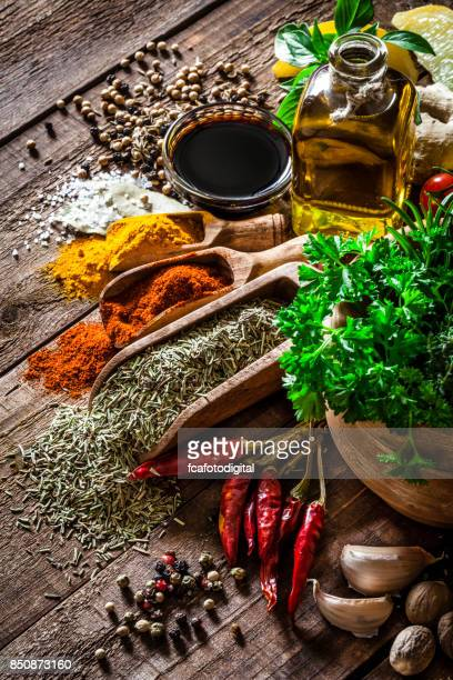 Spices and herbs on wooden kitchen table