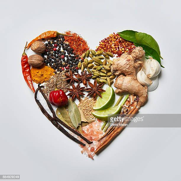 Spices arranged in a heart shape.