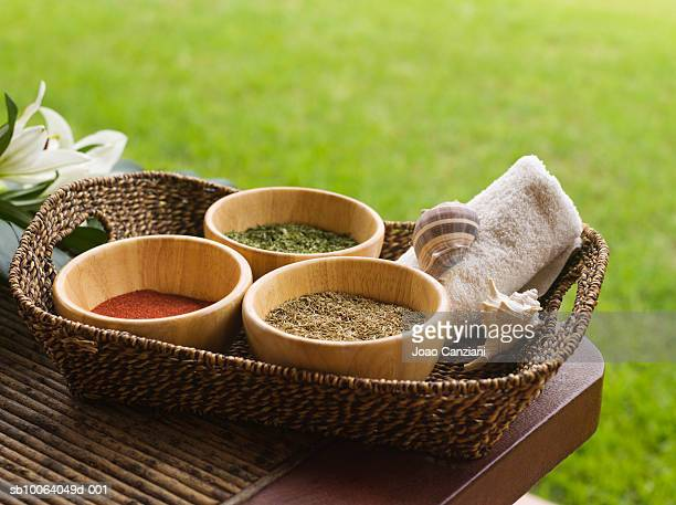 Spices in basket on table outdoors