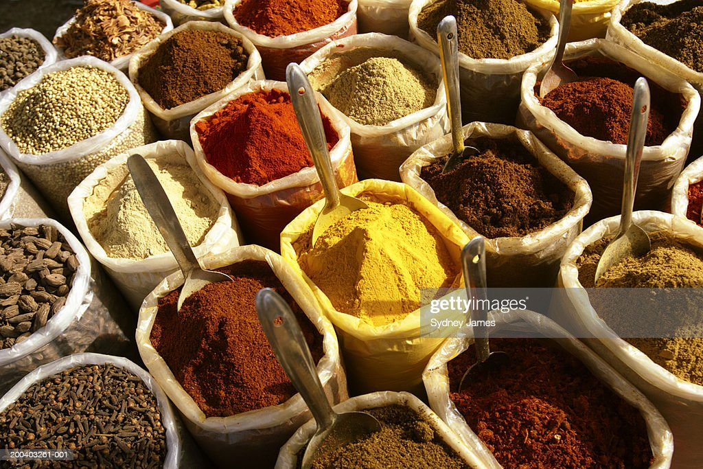 Spices in containers at market : Stock Photo