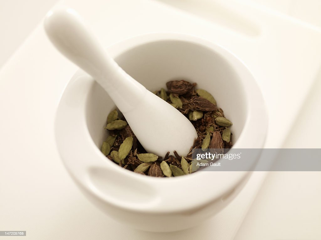 Spices in mortar with pestle : Stock Photo