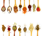 Spices in spoons isolated on white background. Top view.