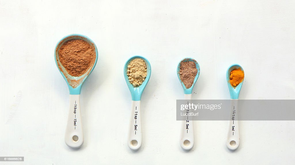 Spices in spoons : Stock Photo