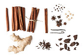 Cinnamon , black pepper , cloves , vanilla , star anise , ginger and chocolate on the white background