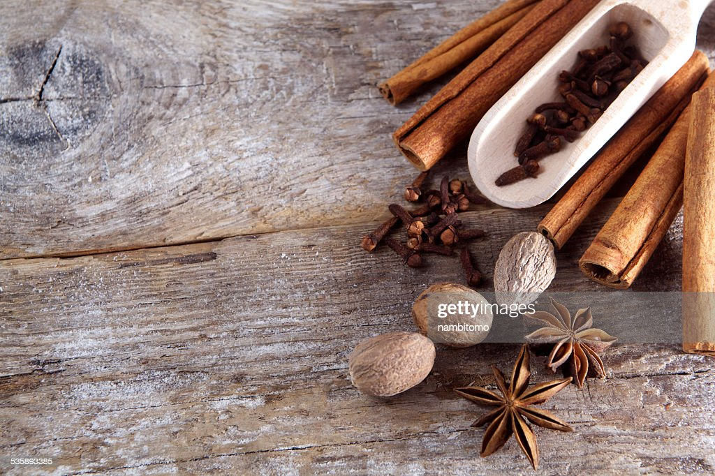 Spices on wooden background. : Bildbanksbilder