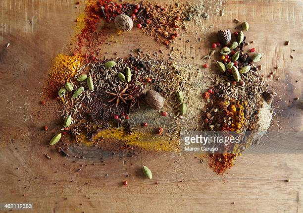 Spices Piled on Wood Surface