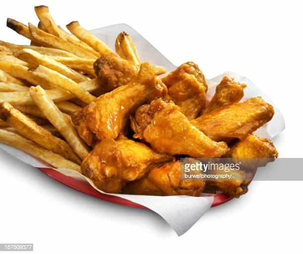 Spicey Chicken Wings and fries, white background