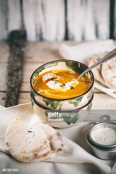 Spicy carrot soup with naan bread and pistachio yoghurt