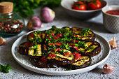 Spicy eggplant with tomato sauce and cilantro. Grilled eggplant.