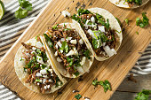 Spicy Homemade Beef Barbacoa Tacos with Cilantro Cheese and Onion