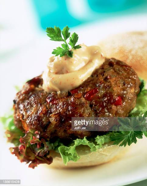 Spicy lamb burger on lettuce & a roll