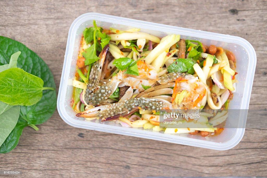 Spicy mango salad with horse crab : Foto de stock