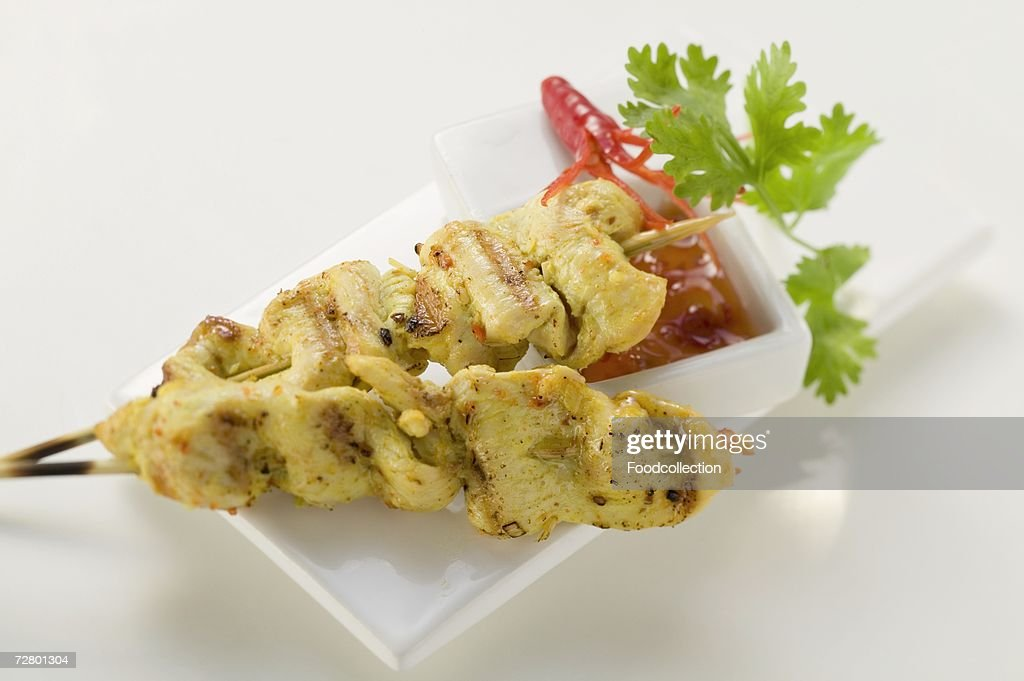 Spicy satay with sweet and sour chili sauce : Stock Photo