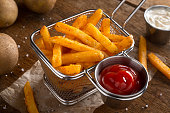Delicious crispy seasoned french fries with ketchup and mayonnaise.
