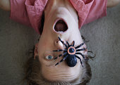 Spider on face showing spider phobia
