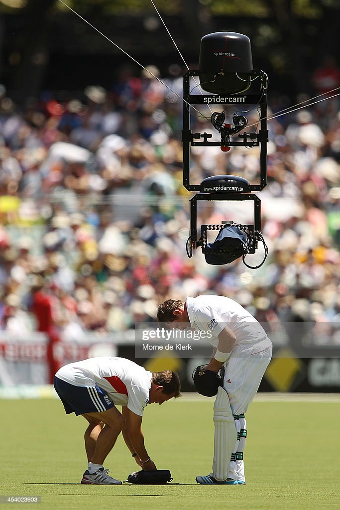 Spidercam films Ian Bell of England as he adjusts his helmet during day three of the Second Ashes Test match between Australia and England at...