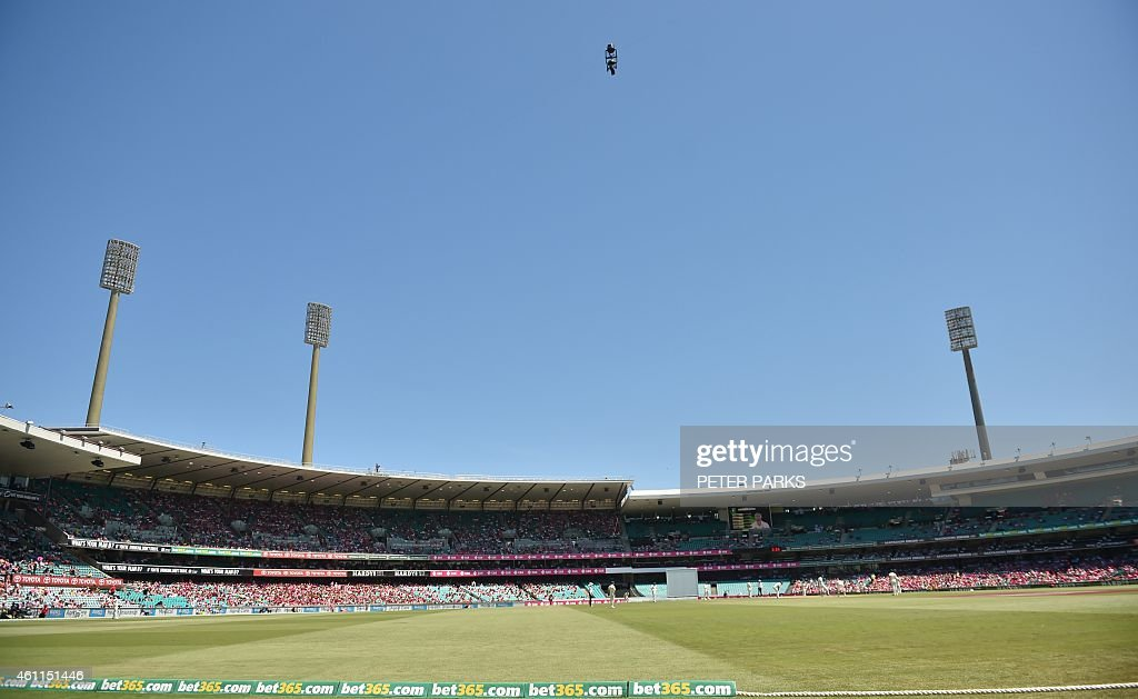 A 'spidercam' is seen above the field of play during day three of the fourth cricket Test between Australia and India at the Sydney Cricket Ground on...