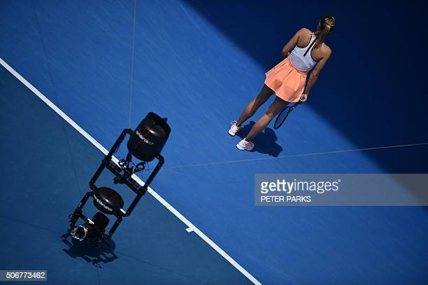 A 'spidercam' television camera hangs over the court as Russia's Maria Sharapova waits to receive serve during her women's singles match against...