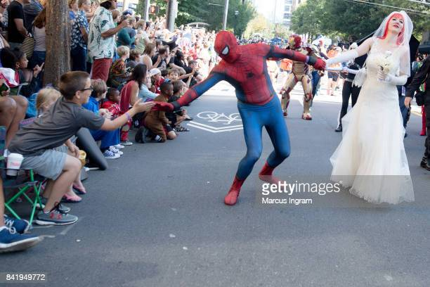 Spiderman and his bride greet fans during the 2017 DragonCon Parade on September 2 2017 in Atlanta Georgia DragonCon is a multimedia convention held...