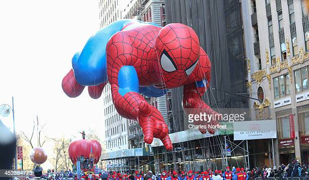 Spiderman ballon floats over the streets during the 87th Annual Macy's Thanksgiving Day Parade on November 28 2013 in New York City