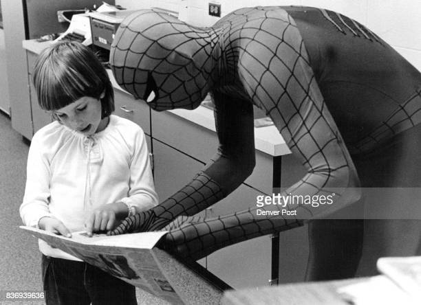 Spiderman Helps Kids Negotiate 'Web of Learning' Clad in his shiny red and blue disguise Spidey helped Amanda McFadden a Cotton Creek Elementary...