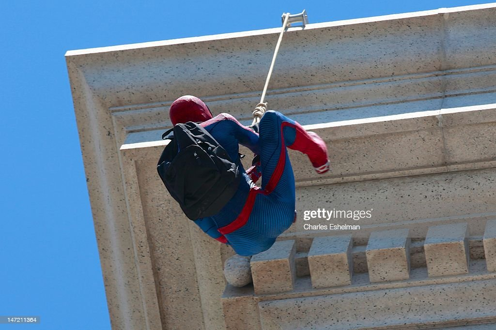 Spider-Man propels for roof to deliver a Chilean Rose Tarantula to the American Museum of Natural History on June 27, 2012 in New York City.