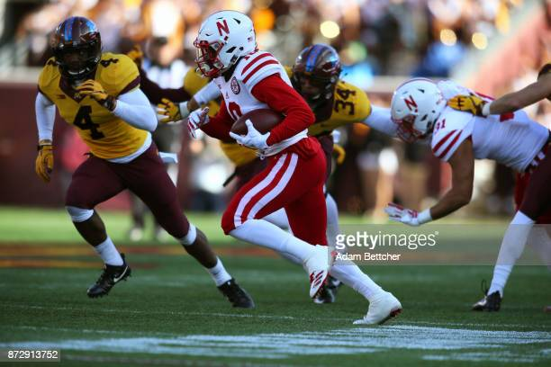 Spielman of the Nebraska Cornhuskers carries the ball for a gain against the Minnesota Golden Gophers at TCF Bank Stadium on November 11 2017 in...