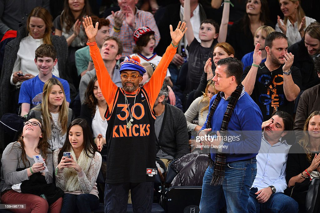 Spike Lee and guest attend the New Orleans Hornets vs New York Knicks game at Madison Square Garden on January 13, 2013 in New York City.