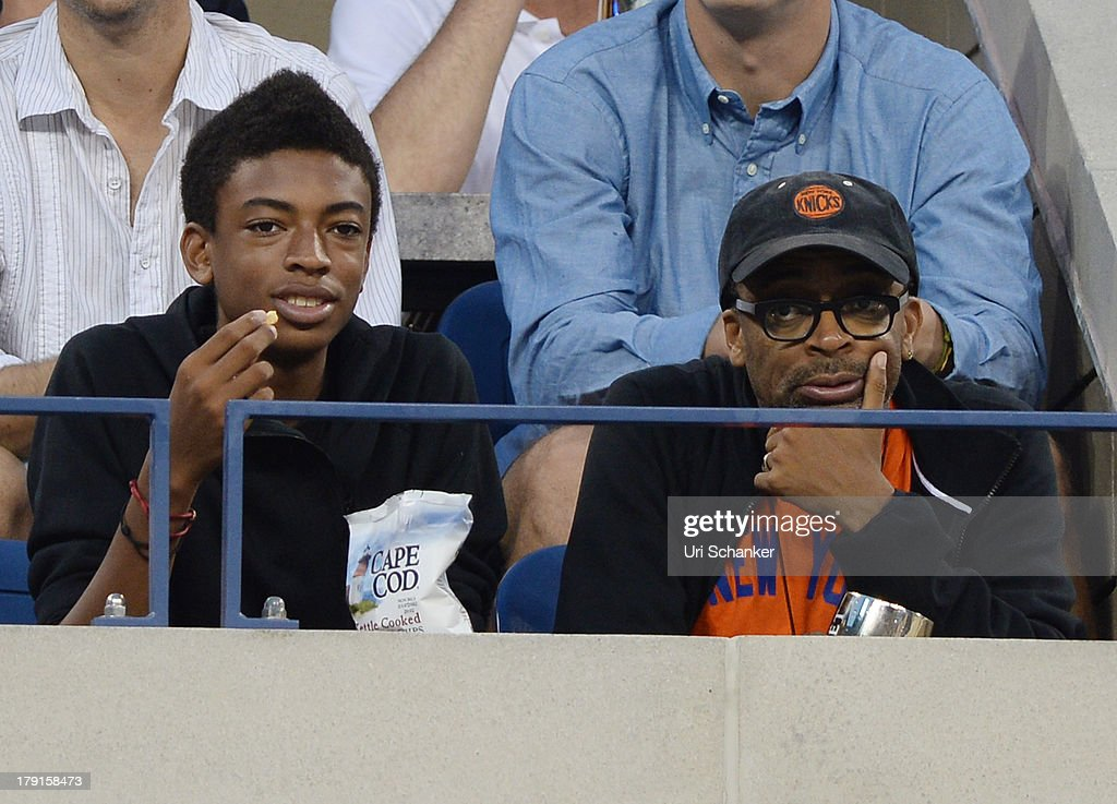 Spike Lee and his son attend the 2013 US Open at USTA Billie Jean King National Tennis Center on August 31, 2013 in New York City.