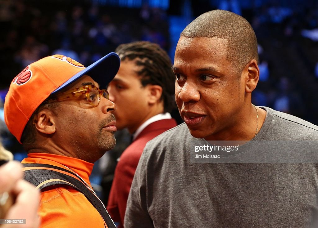 Spike Lee (L) and Jay-Z meet prior to the NBA game between the Brooklyn Nets and the New York Knicks at Barclays Center on December 11, 2012 in the Brooklyn borough of New York City.The Knicks defeated the Nets 100-97.