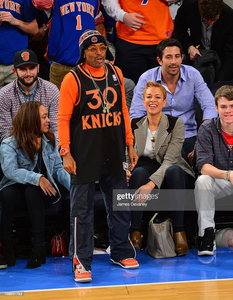 Spike Lee and Tonya Lewis attend the Chicago Bulls vs New York Knicks game at Madison Square Garden on December 21, 2012 in New York City.