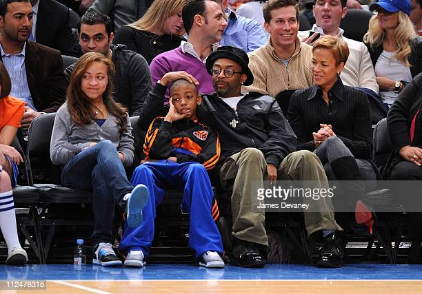 Spike Lee and wife Tonya Lewis Lee attend Sacremento Kings vs New York Knicks game with their children Satchel Lee and Jackson Lee at Madison Square...