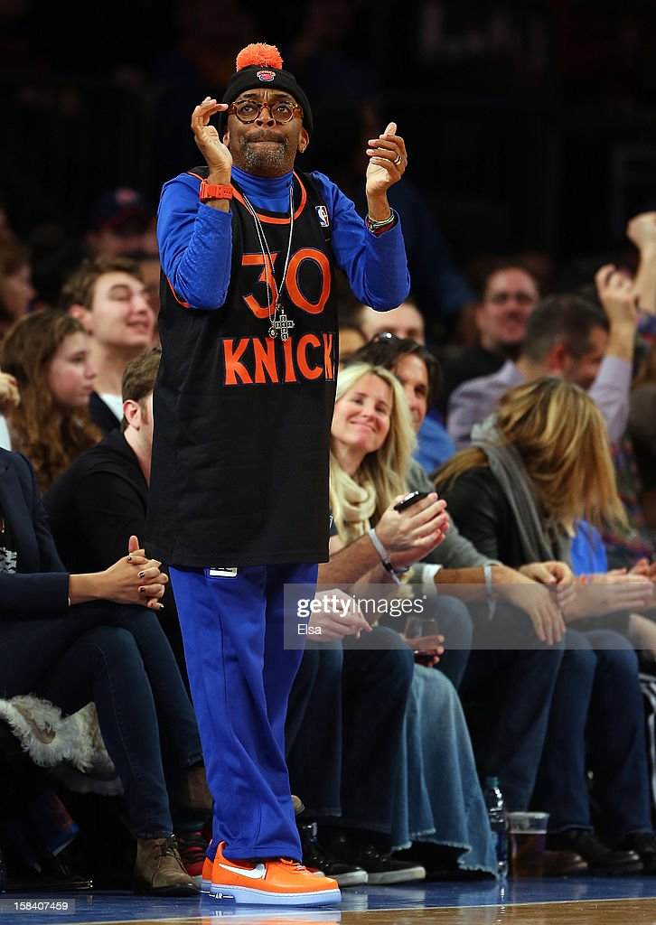 Spike Lee celebrates after a New York Knicks basket in the first half against the Cleveland Cavaliers on December 15, 2012 at Madison Square Garden in New York City.