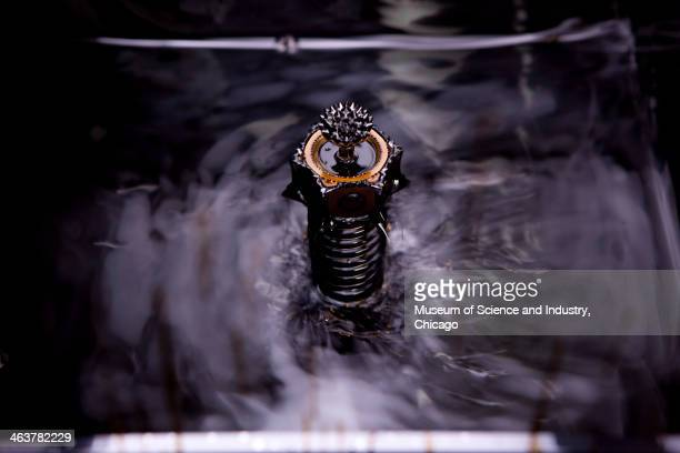 Spiked patterns in ferrofluid a liquid invented by NASA in the 1960s for the Apollo program are formed when a magnetic field is present as seen in...