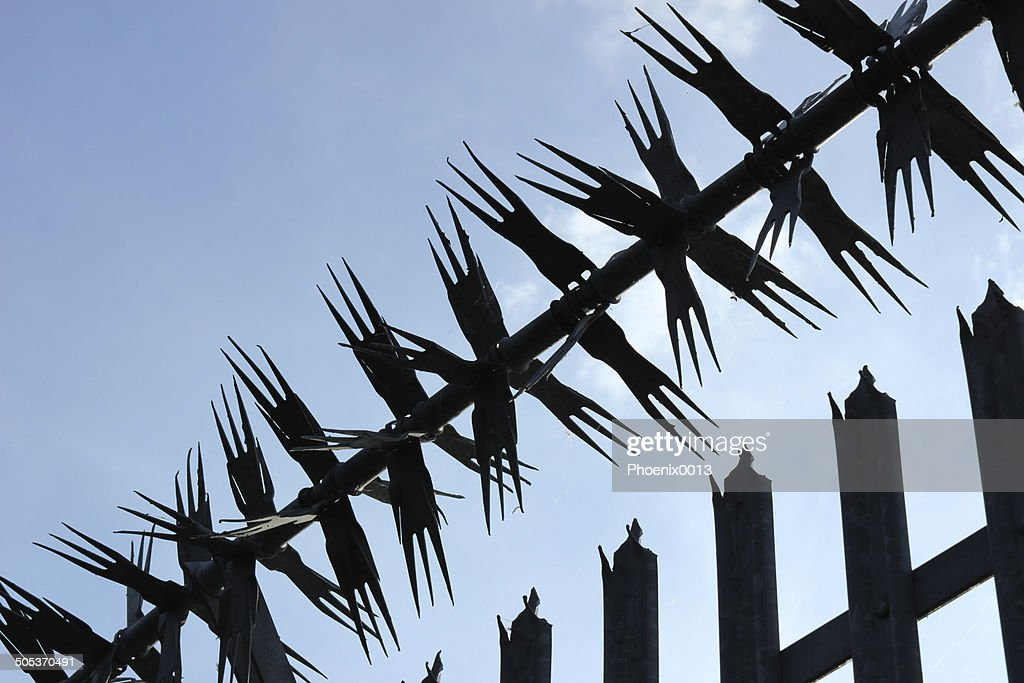spiked security fence stock photo