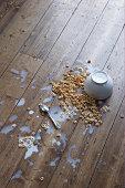 Cair Cereais de pequeno-almoço no Chão