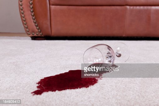 Spilled glass of wine on new carpet