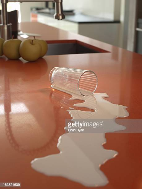 Spilled milk on kitchen counter