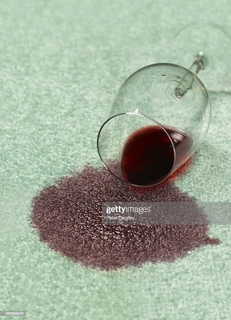 Spilled red wine on carpet : Stock Photo
