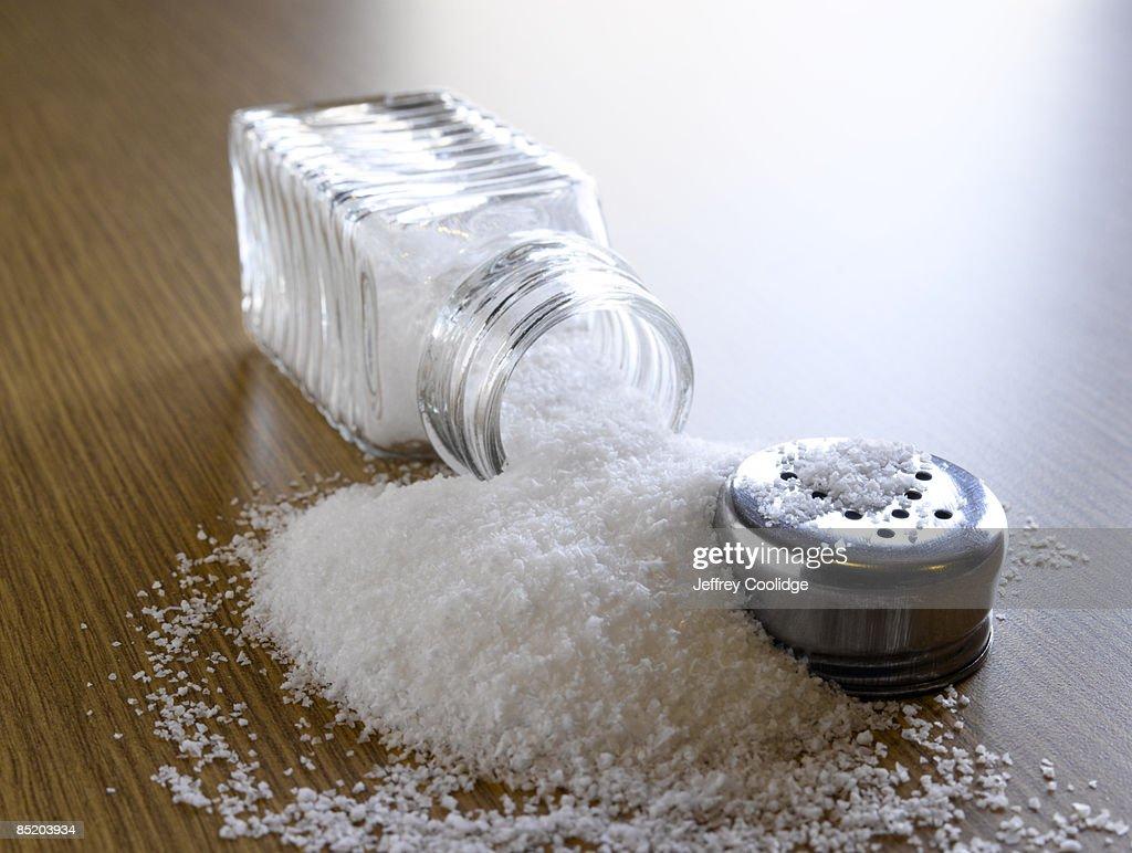 Spilled Salt and Shaker : Stock Photo