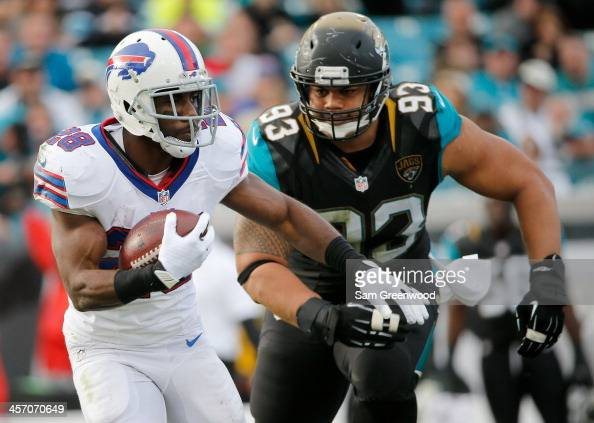 J Spiller of the Buffalo Bills attempts to run past Tyson Alualu of the Jacksonville Jaguars during the game at EverBank Field on December 15 2013 in...