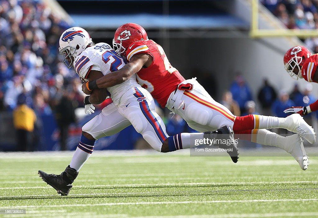 C.J. Spiller #28 of the Buffalo Bills is tackled during NFL game action by Eric Berry #29 of the Kansas City Chiefs at Ralph Wilson Stadium on November 3, 2013 in Orchard Park, New York.